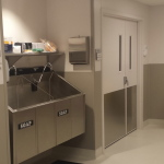 Two Bay Surgical Scrub Sink wall hung with chair carrier