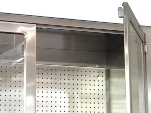 stainless steel pegboard in OR surgical table accessory cabinet close up