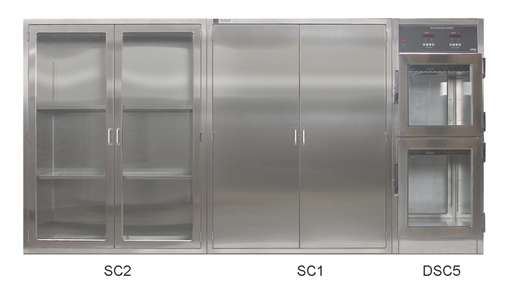 CMP Stainless Steel OR Storage Console containing; SC2 Storage cabinet with adjustable shelves and shatter-proof glass, SC1 Accessory cabinet with peg board and hooks and DSC5 Solution/Blanket warming cabinet with dual electric heated compartments and glass doors