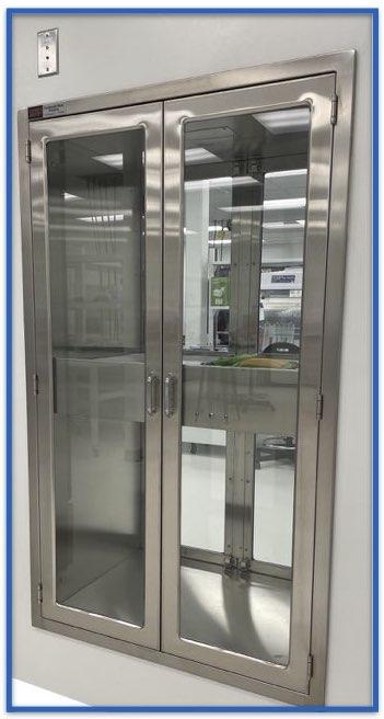 pass through cabinet with indicator light to alert staff when door is open in the adjacent room. Red- door is open, green- door is closed